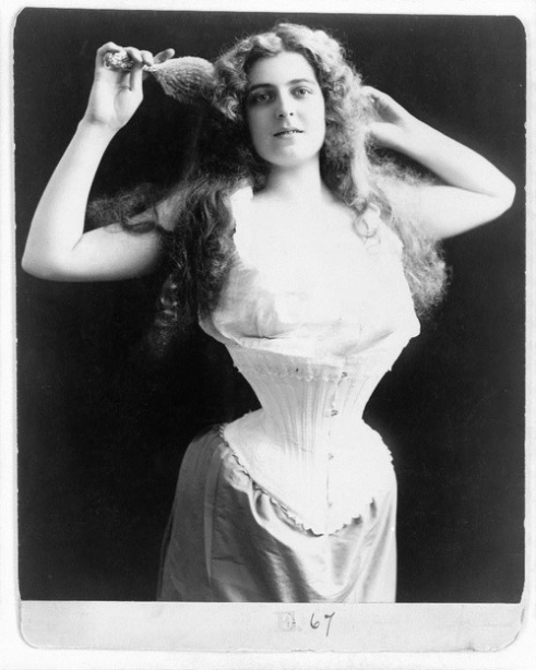 Portrait of Woman Wearing Corset, ca. 1899.